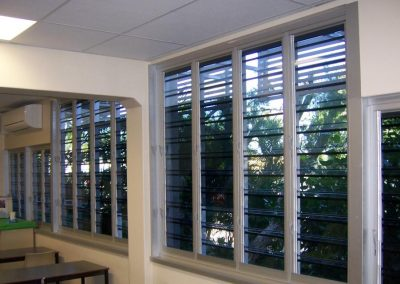 Breezway louvres with security bars protect the school after hours