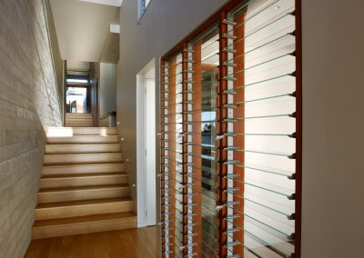 Altair Louvres can be installed in timber frames to match other windows inside the home.