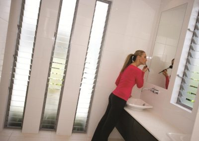 Privacy and fresh air can be achieved by angling obscure satina louvre blades from Breezway.