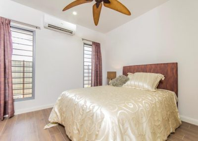 Aluminium windows in the bedroom with air conditioning above if required