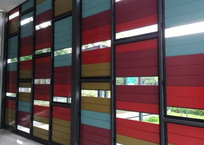 Internal Nova Pantai with Breezway Louvres and coloured glass