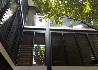 Outdoor wall of breezway louvres
