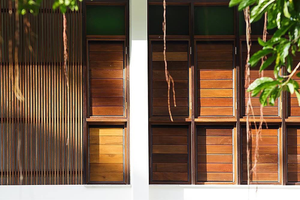 Close up of Breezway louvres with timber blades from the outside