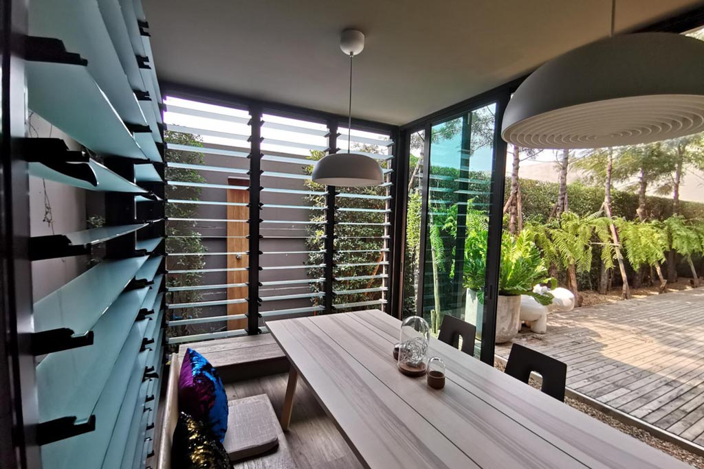 Breezway Louvres wide open allow fresh air to ventilate protected sitting area